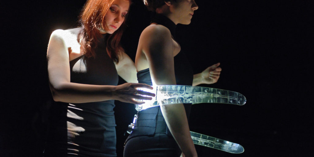 The Prosthetic Ribs have touch-sensitive panels along their length. Here Marjolaine Lambert plays the Ribs while they are worn by Sophie Breton.  Photo ©Michael Slobodian.
